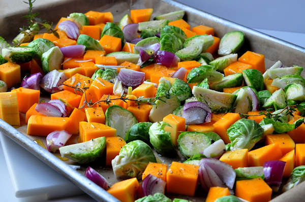 cut fall vegetables on sheet pan