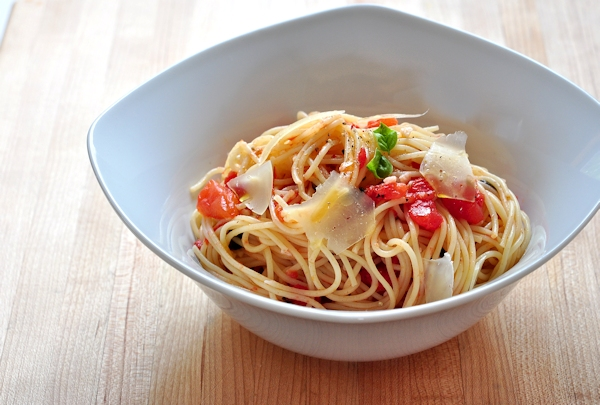bowl of pasta with fresh tomatoes and basil