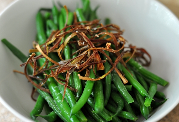 bowl of string beans with crispy leeks