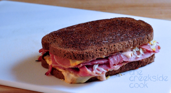 rueben sandwich on cutting borad