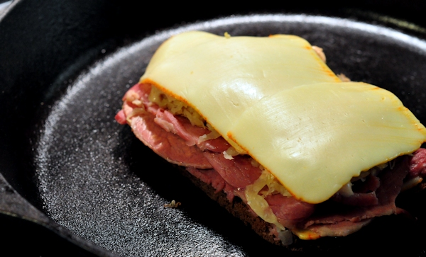 taosting a reuben sandwich